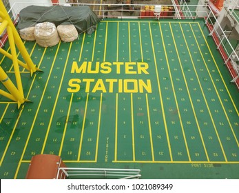 Emergency assembly area or muster station on board offshore marine vessel.  It is a meeting points for crews and passengers during an emergency, typically on the open decks by the lifeboats. - Shutterstock ID 1021089349