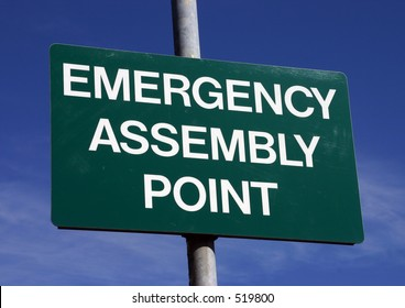 An emergency assembly point sign.