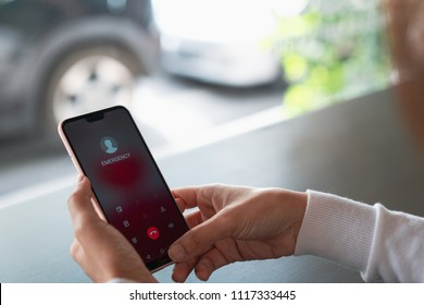 Emergency call use by smartphone, Women using a digital generated phone with emergency call on the screen. All screen graphics are made up, Emergency concept
