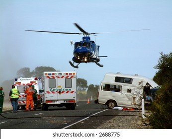 Emergency chopper helicopter air lift, with patient on board at road crash scene with accident ambulance police and paramedics at high speed road crash involving car motorhome campervan holiday toll