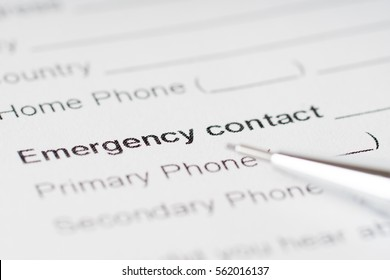 emergency contact paper sheet with phone number
