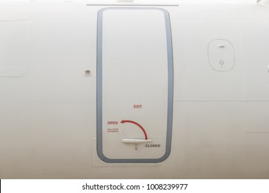 Emergency door exit on the plane. Traveling by plane is a fast and secure journey.