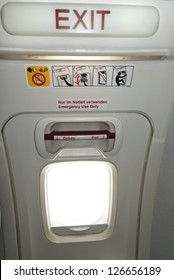 Emergency exit in the aircraft, text in English and German