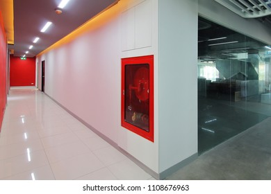 Emergency exit of the building with fire exit sign,fire alarm and Fire extinguisher