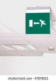 Emergency exit, green sign in a white roof