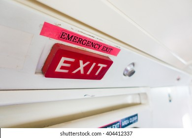 Emergency exit label and red sign sticker on aircraft door.Exit label put on top of door.Emergency Exit wording sign sticker is use for tell customer mostly on door in aircraft building and vehicle.