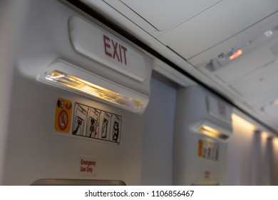 Emergency Exit and Light in Aircraft Cabin