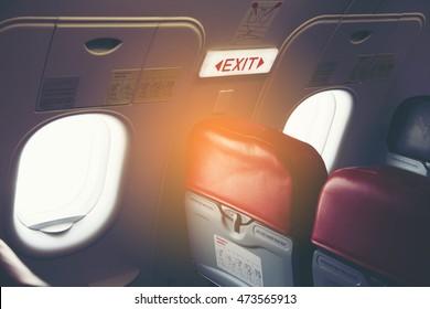 Emergency Exit Seat Closeup shot of emergency exit door in airplane emergency exit row in airplane