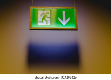 Emergency exit sign arrow down