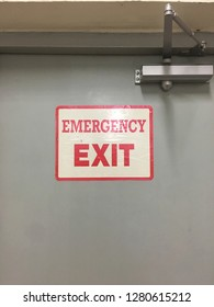 Emergency exit sign attached on the door