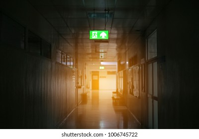 Emergency exit sign with fire in the building.
