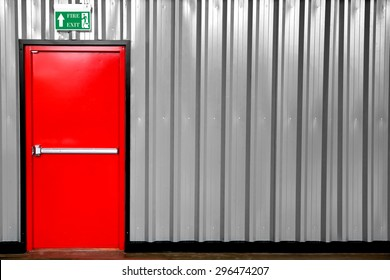 Emergency Exit with Exit Sign and Fire Extinguisher