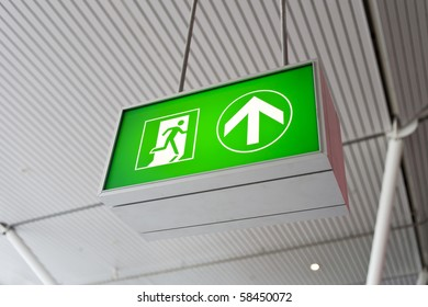 Emergency exit sign glowing green