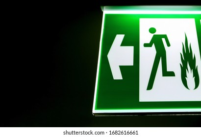 Emergency exit sign hanging on the wall with copy space