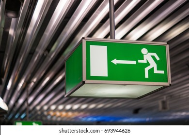 Emergency exit sign at an international airport