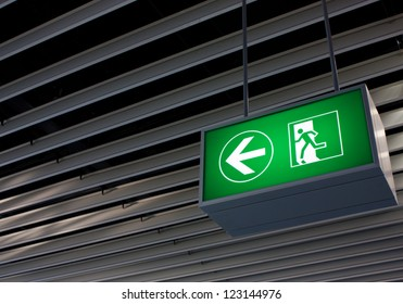 Emergency exit sign in modern offices inside an industrial plant