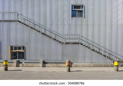 Emergency exit stairs on an exterior of a corrugated wrapped building.
