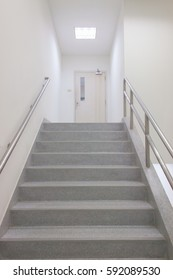 Emergency Exit in workplace, stairwell in a modern building