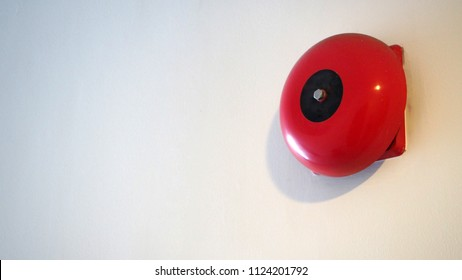 Emergency Fire alarm or alert or bell warning equipment red color on white background wall in the building for safty.