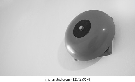 Emergency Fire alarm or alert or bell warning equipment red color on white background wall in the building for safty in black and white picture.