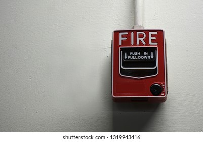 Emergency Fire alarm on white background wall in the building for safety.