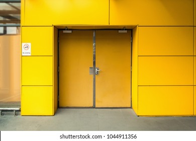Emergency Fire Exit Door and Facade Aluminum Composite of Warehouse, Steel Doorway and Fire Proof Resistant of Security System. Modern Architecture Access Door of Commercial Building for Fire Safety
