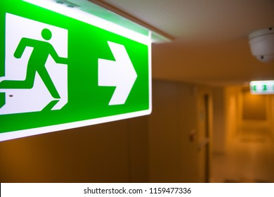 Emergency Fire exit sign at  the corridor in building