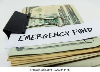 EMERGENCY FUND : A money saving goal inspiration with  closeup of US dollars in paper clip on white background.