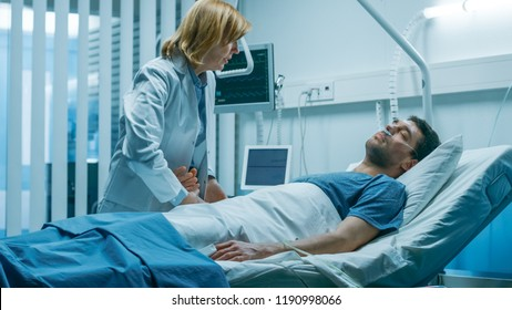 Emergency in the Hospital, Doctor Rush to Safe Dying Patient. Man is Lying on the Bed without Signs of Life. Doctor Holds Hand to Check His Heart Rate.
