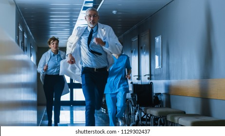 Emergency in the Hospital, Doctors and Nurses Running through the Hallway, in a Hurry to Save Lives.