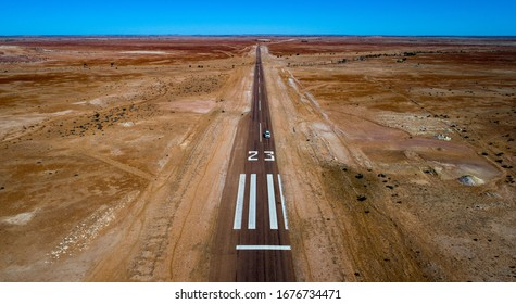 Emergency landing strip 23 is located on the highway 57km east of the outback town of Birdsville. These remote strips are used by the Royal Flying Doctor Service in emergency situations.