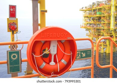 Emergency life buoy station at oil and gas platform.
