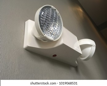 Emergency light auto lighting with two bulbs working during power outage by battery.