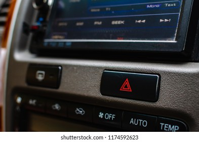 Emergency light botton at dashboard in a car.