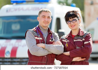 Emergency Medicine. Doctor with colleague paramedic on ambulance vehicle background