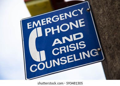Emergency Phone and Crisis Counseling Sign on Golden Gate Bridge