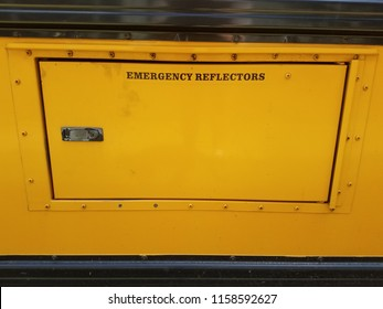 emergency reflectors sign on door on yellow school bus