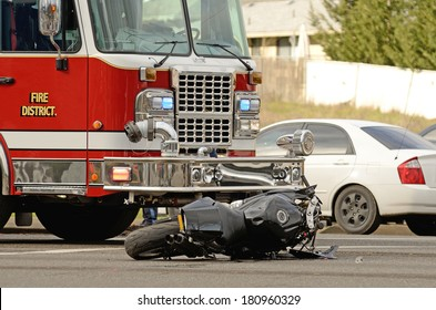 Emergency responders at the scene of a motorcycle vs car at a busy intersection that left the rider with serious injuries.