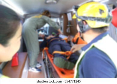 emergency response team help the victim with the first aid treatment in the ambulance