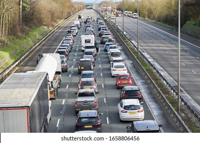 Emergency services closing motorway to attend accident causing a traffic jam