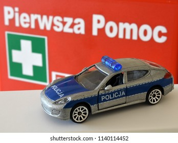 Emergency services and an inscription in Polish: first aid
