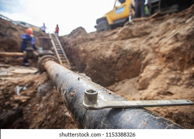 emergency services, the repair team provides safety during the replacement of pipes, old communications are changed to new ones, the gas pipeline, the old and rusted water pipe with dirty gates, repla
