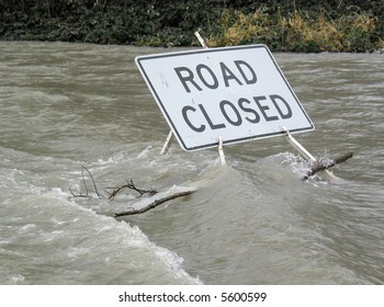 Emergency Sign on Flooded Road
