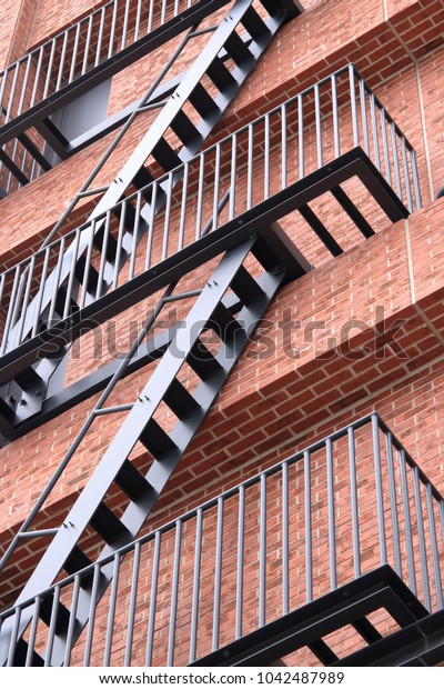 Emergency staircase, brick building background