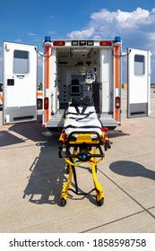 Emergency stretcher and EMS ambulance with open door
