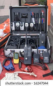 a lot of emergency transceivers in a case