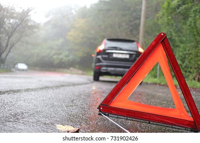 Emergency warning triangle, a broken car