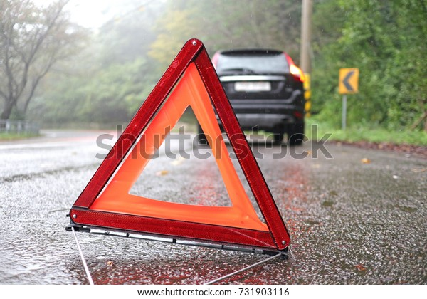 Emergency warning triangle, a broken car