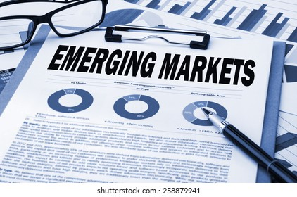 emerging markets analysis concept on clipboard
