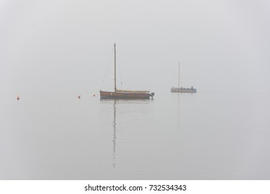 Emigration boats with passengers in fog on Lake Steinhude
